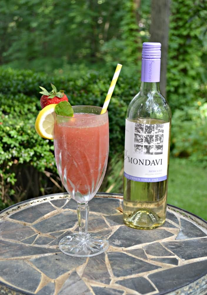 Grab a straw and take a big sip of this Frozen Strawberry Lemonade Moscato Punch!