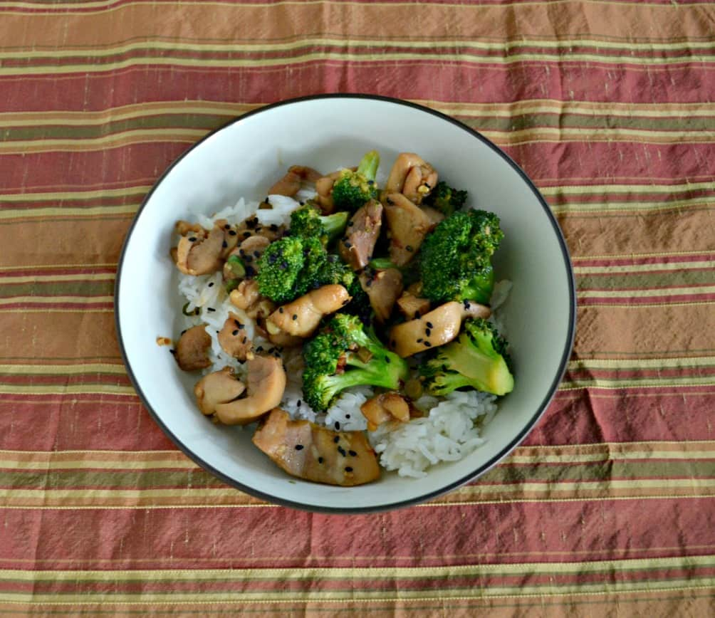 This delicious weeknight meal is Chicken Thighs with Broccoli with a Ginger Sesame Glaze in a rice bowl