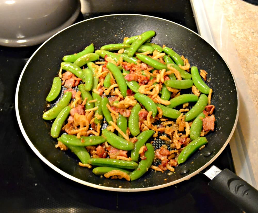 Not sure about peas? Try this delicious Peas with Bacon and Crispy Onions!