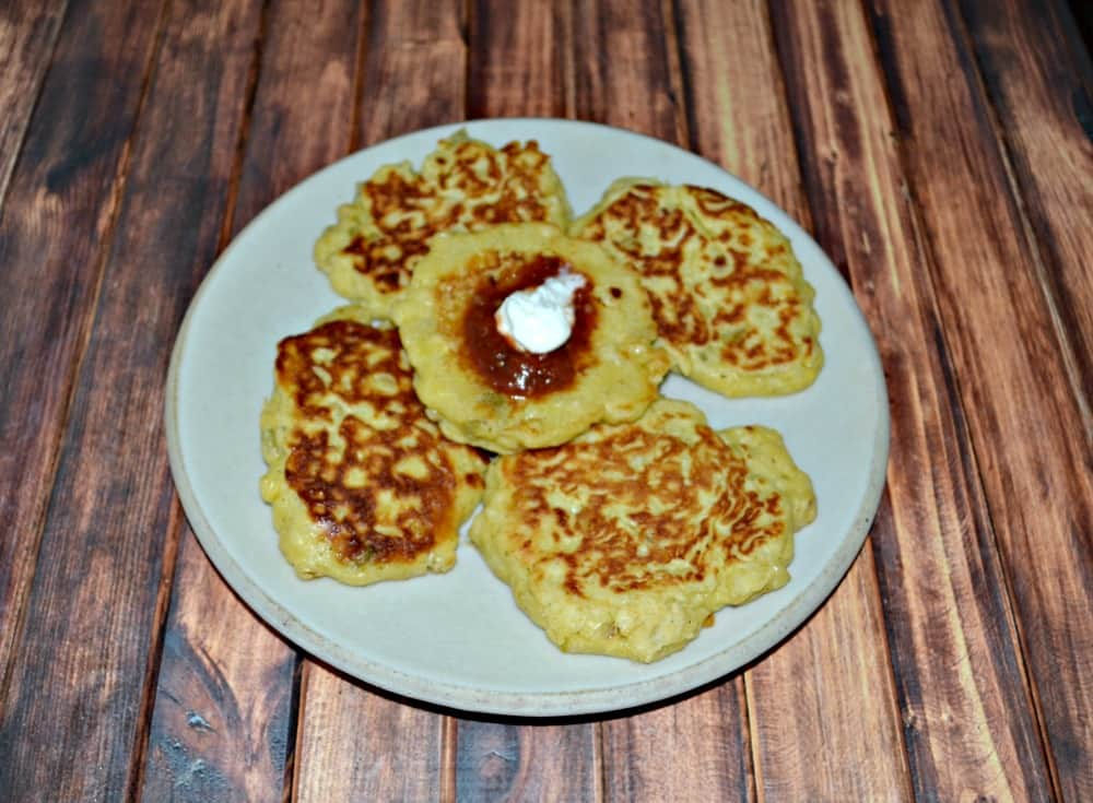 WIth corn in season these Fresh Corn Cakes topped with salsa and sour cream are a favorite late summer side dish!