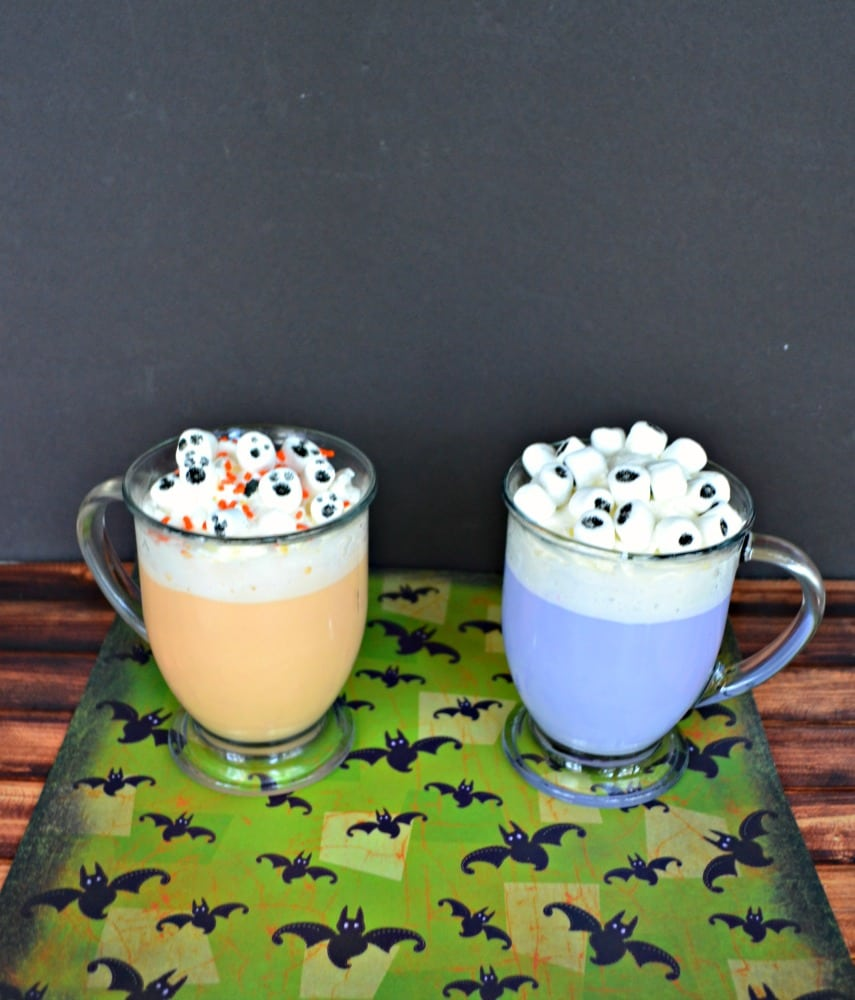 "This fun Halloween Hot Chocolate is topped with ""ghosts"" and ""eyeballs""."