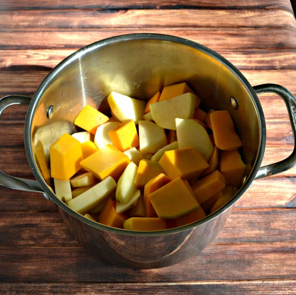 Boil potatoes and butternut squash to make delicious Butternut Mashed Potatoes!