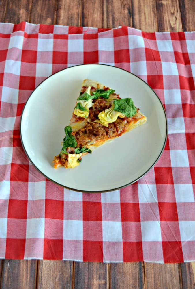 Make your own delicious pizza at home with Spinach, Chorizo, and Artichokes!