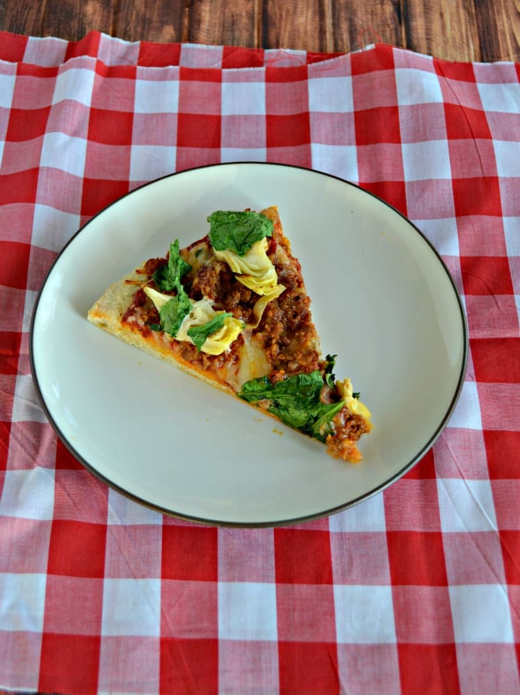 Grab a slice of this spicy Spinach, Chorizo, and Artichoke Pizza!