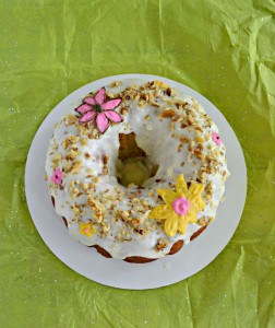 Grab a slice of this tropical Hummingbird Cake with bananas, pineapple, pecans, and a cream cheese glaze with chocolate flowers on top!