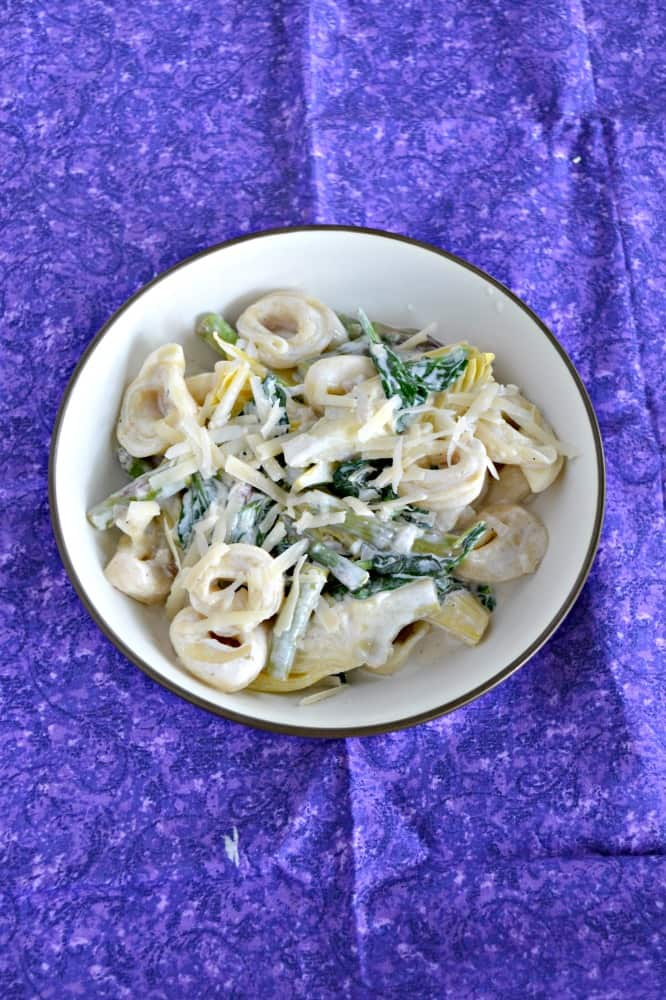 Families will love this easy Spinach Artichoke Tortellini with Creamy Lemon Sauce