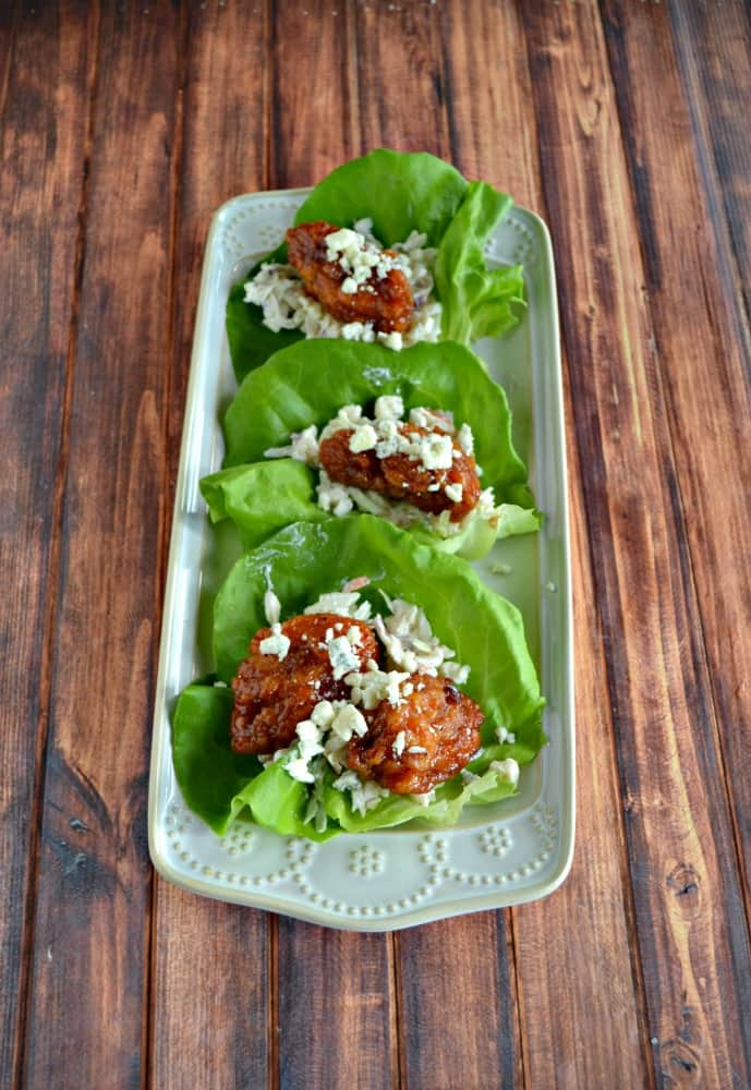 These Boneless BBQ Chicken Wing Lettuce Wraps with coleslaw and blue cheese is a tasty Game Day snack.