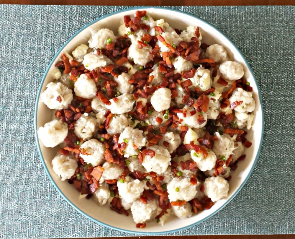 Dig into this traditional Halusky: Potato Dumplings with Sheep cheese, bacon, and chives!