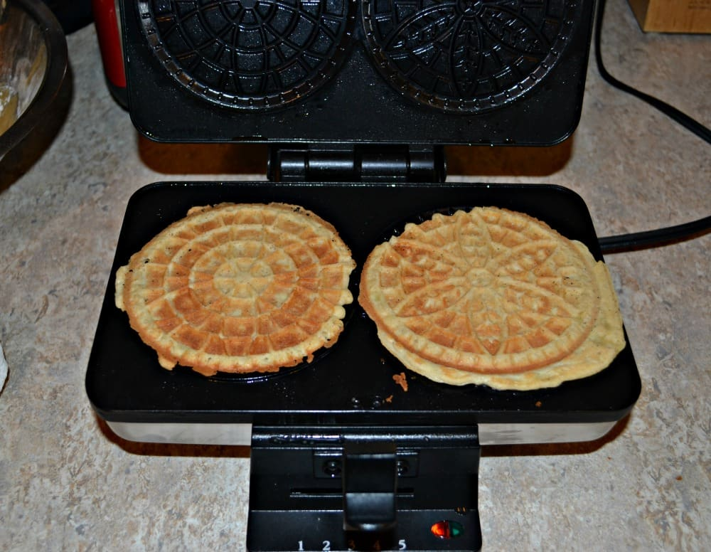 Grab a Pizzelle Maker and make a batch of these tasty spiced vanilla Pizzelles