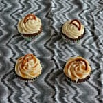 Ready for a fun holiday dessert? These Salted Caramel Chocolate Cupcakes topped off with a pretzel are a fun holiday treat!