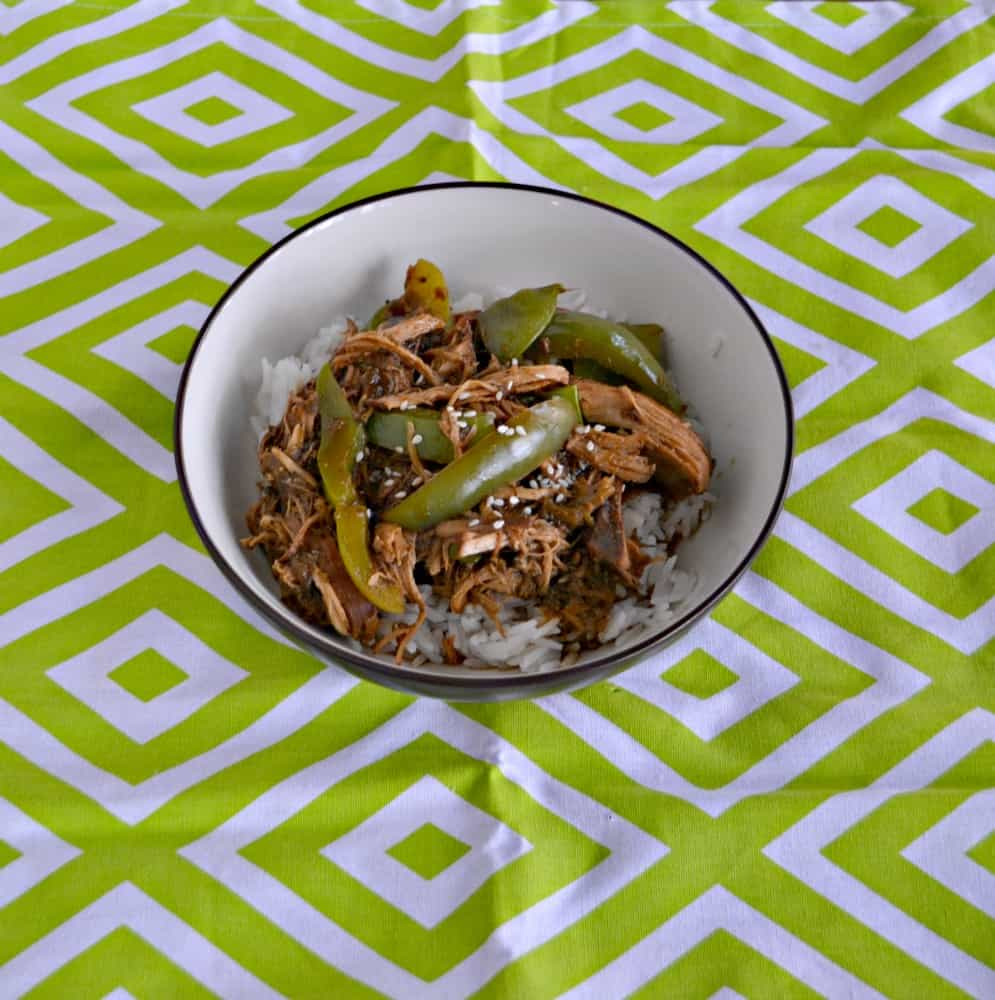 Looking for an easy weeknight meal? Check out my delicious Sweet and Spicy Slow Cooker Chicken with Peas and Peppers!