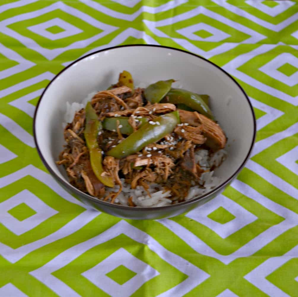 Love this tasty Sweet and Spicy Slow Cooker Asian Chicken with Peppers and Peas
