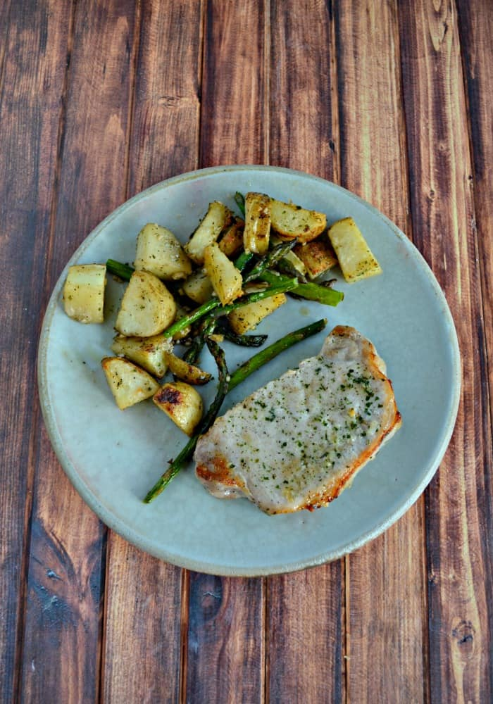 Need a delicious weeknight meal? Try this tasty 30 minute Ranch Pork Sheet Pan Supper!