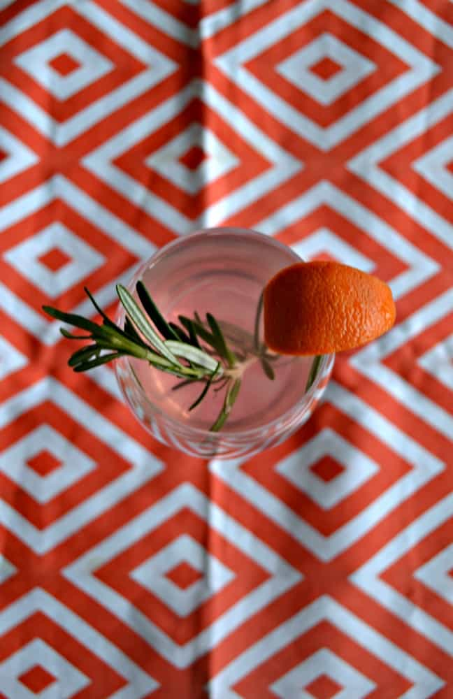 Looking for a flavorful cocktail perfect for a party? Try this festive Blood Orange and Rosemary Sangria!