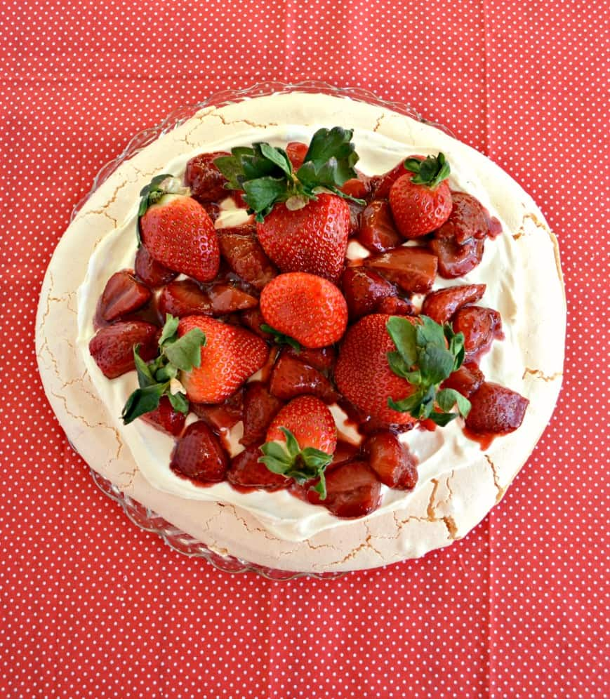 Need a crowd pleasing dessert? Try this light and delicious Roasted Strawberry Pavlova with Lemon Cream