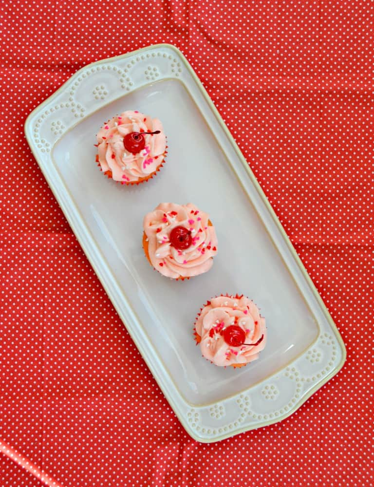 Kids love these fun pink Cherry Cupcakes with a cherry on top!
