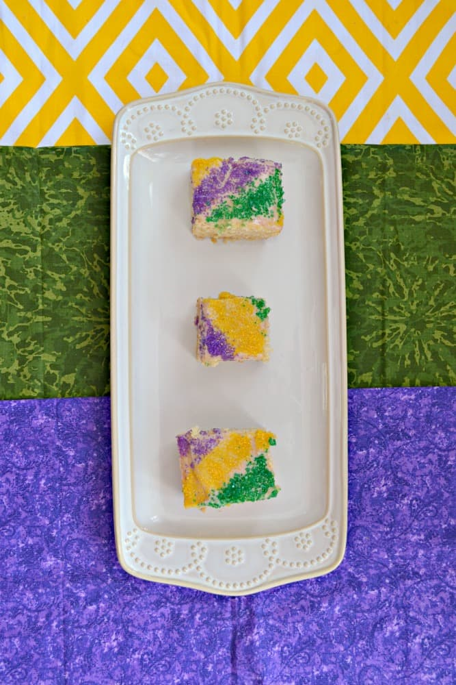 Take a bite of these sweet cinnamon spice King Cake Cookie Bars for Mardi Gras!