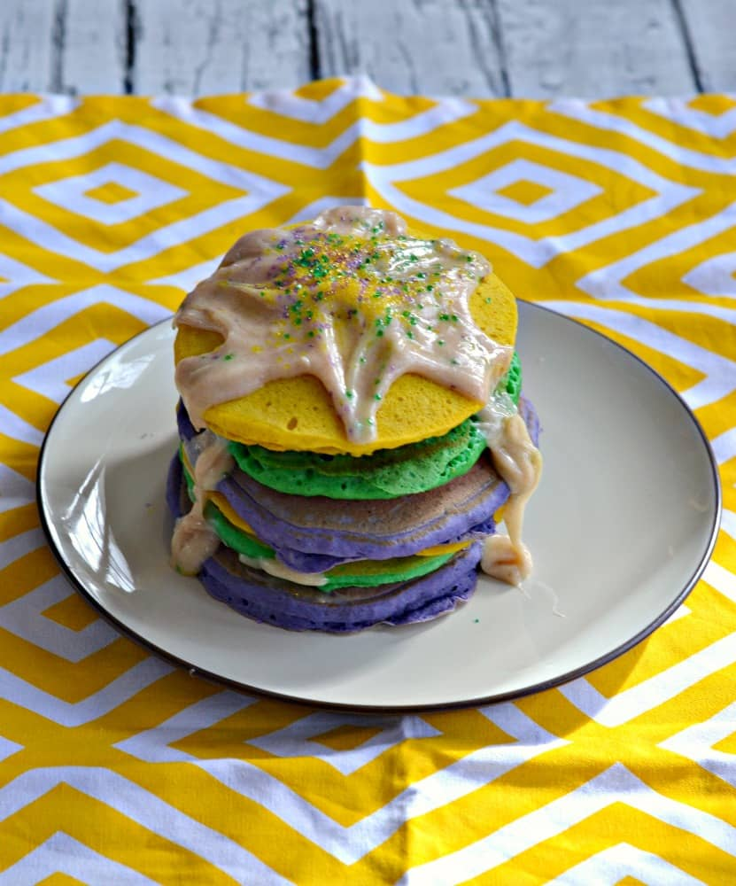 Want to celebrate Mardi Gras with breakfast? Enjoy these colorful and festive King Cake Pancakes with Cream Cheese Drizzle
