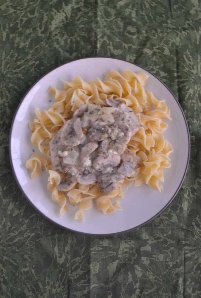 Mushroom Smothered Pork Chops over Noodles