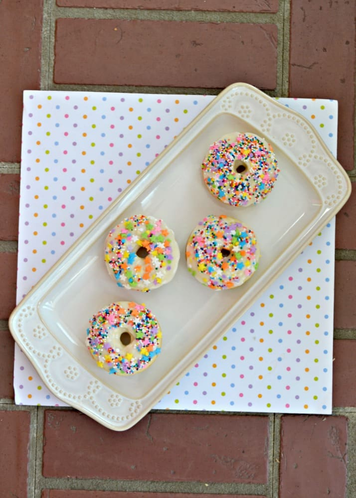 How fun are these Baked Vanilla Donuts with vanilla glaze and sprinkles?