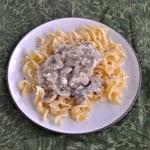 Mushroom Smothered Pork Chops over Noodles #SundaySupper