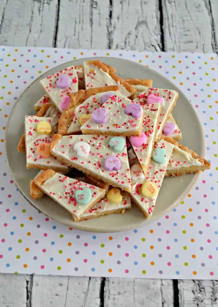 Looking for a Valentine's Day recipe the kids can help with? Try this fun Conversation Heart Sugar Cookie Bark!