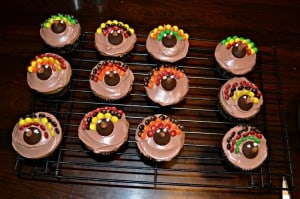 Looking for a Thanksgiving dessert? Make these adorable Turkey Cupcakes with mini M&M's and a Hershey Kiss!