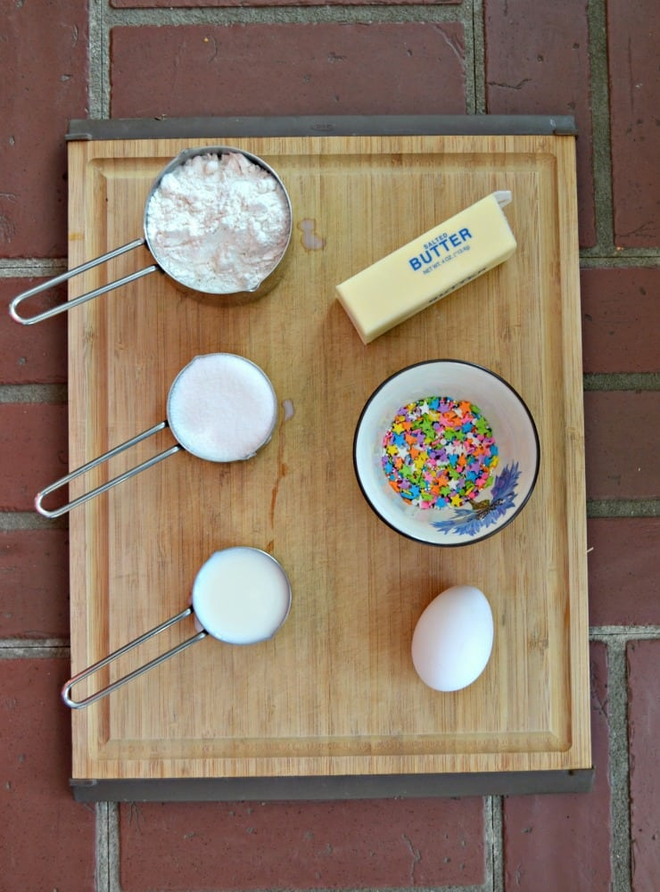 Everything you need to make Baked Vanilla Donuts with sprinkles!