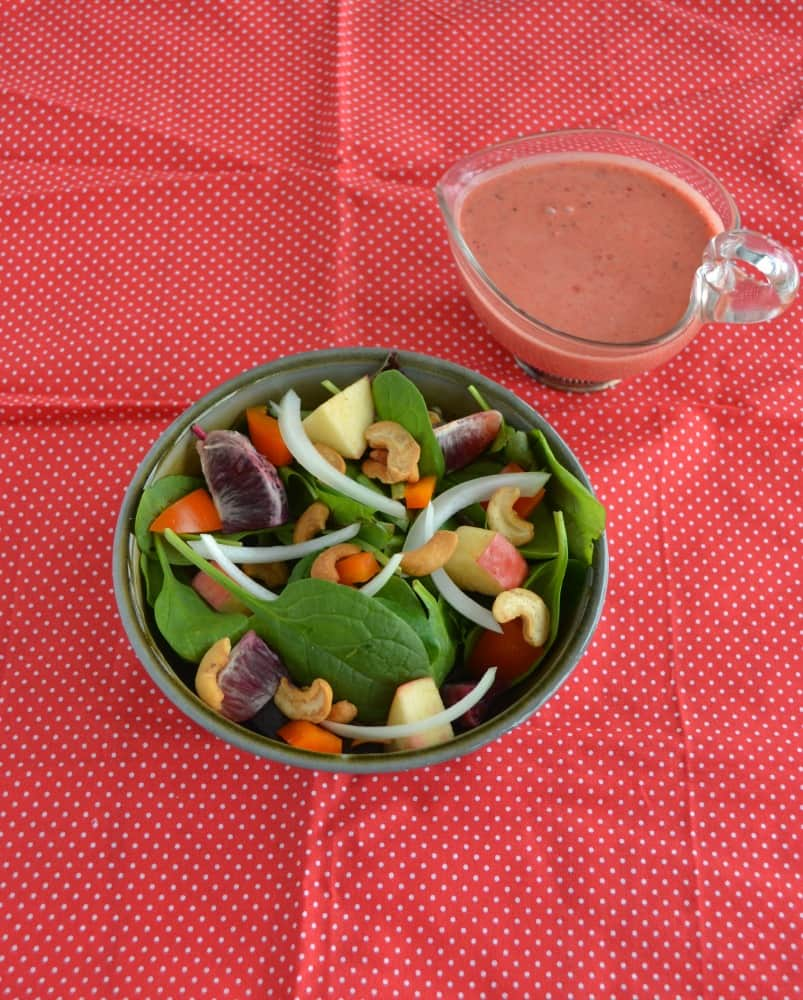 Looking to eat clean? Try this colorful and delicious Fruit and Nut Salad with Berry Vinaigrette!