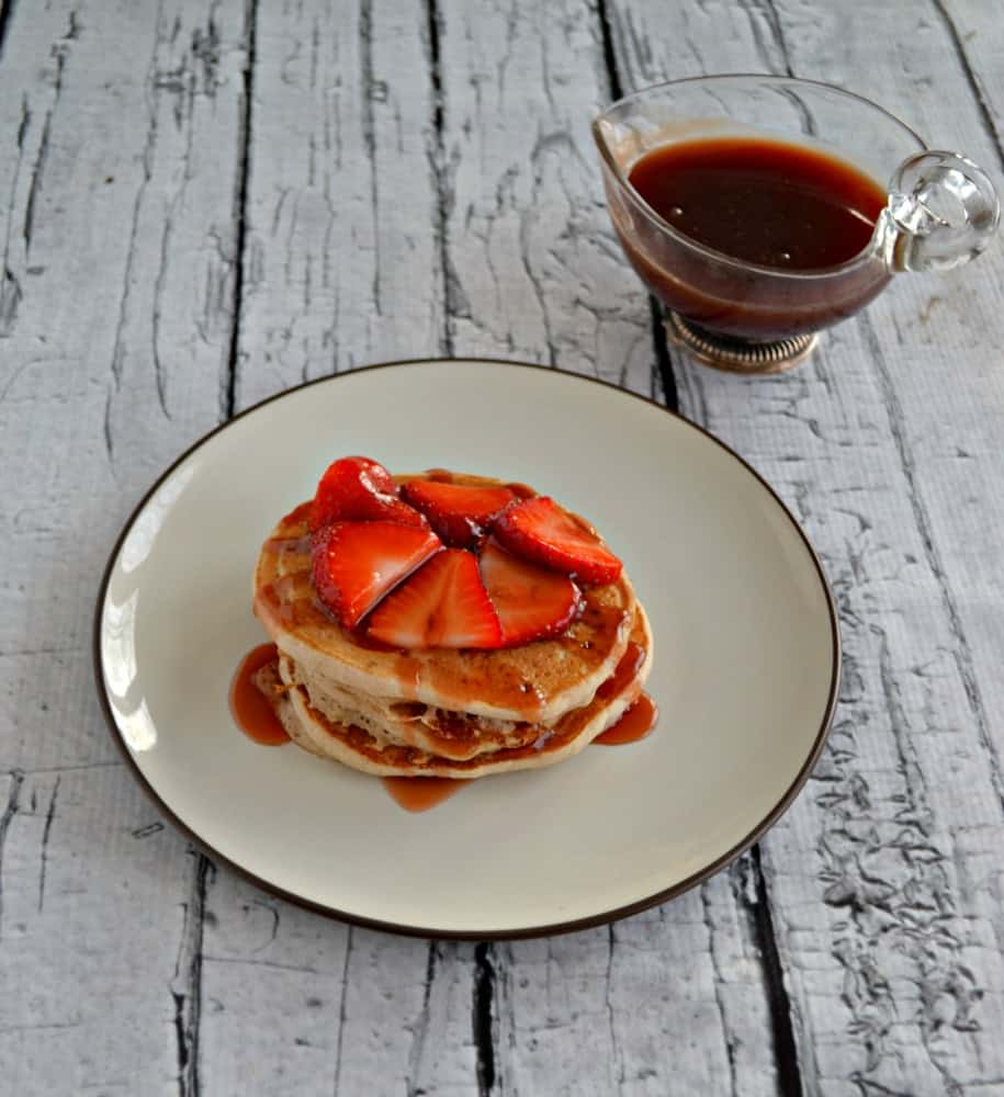 Treat your kids to a breakfast of Strawberry Shortcake Pancakes with homemade Strawberry Syrup