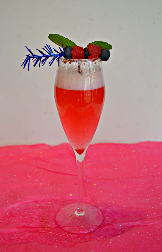 Sip on this refreshing Sparkling Berry Cocktail with raspberries and blueberries!