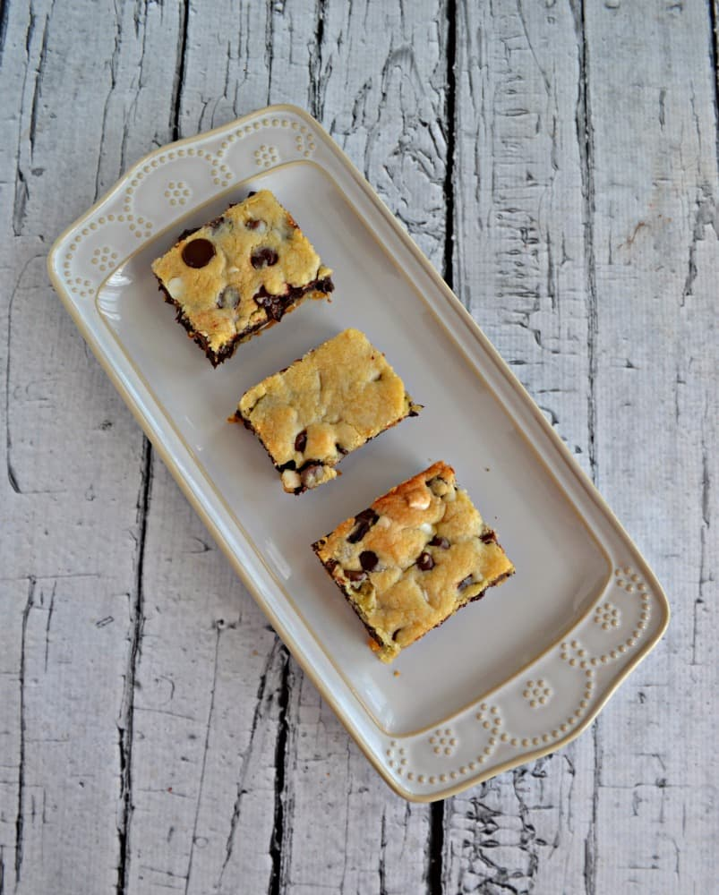 One bite and you'll be sold on these Fudge Filled Chocolate Chip Cookie Bars!