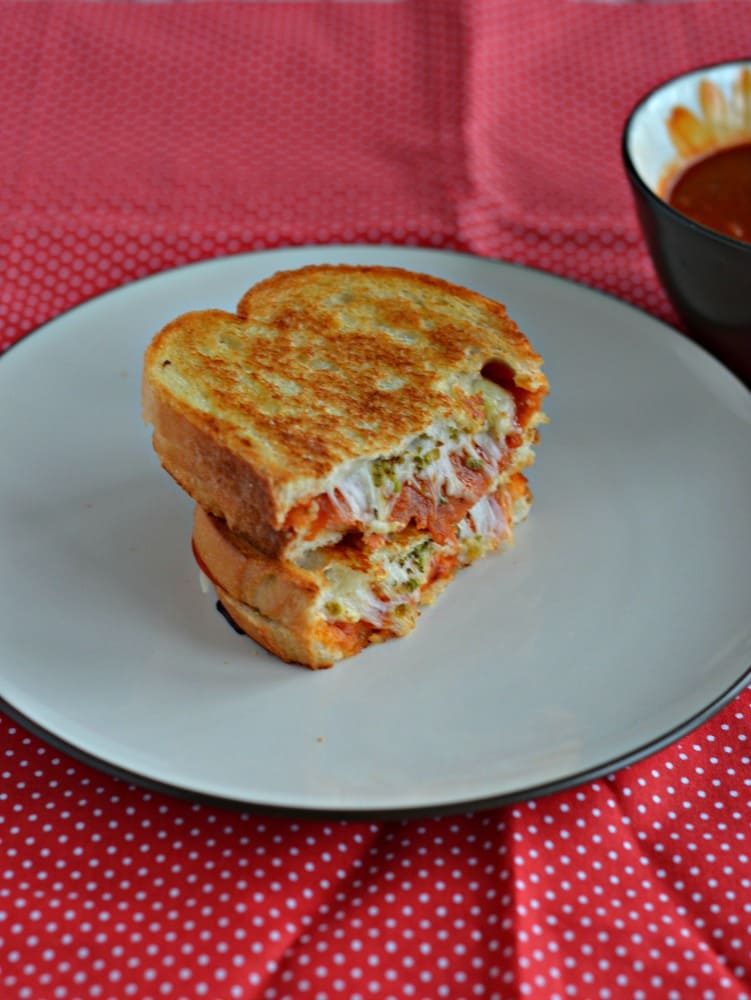 Mix two of your favorites together with this awesome Pizza Grilled Cheese Sandwich