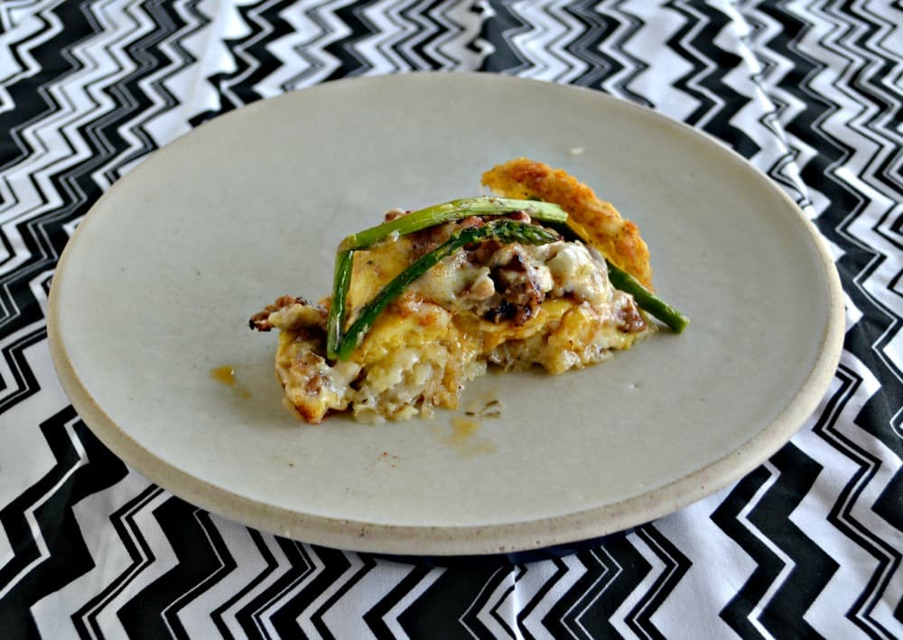 Having a brunch? One this awesome Hash Brown Crusted Casserole with Cheddaar, Eggs, and Asparagus!