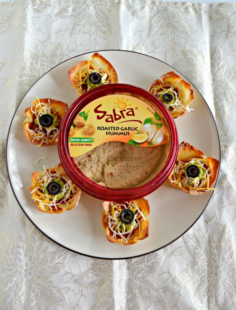 Looking for a snack to fuel you until dinner? Try these easy Hummus Taco Cups ready in about 15 minutes!