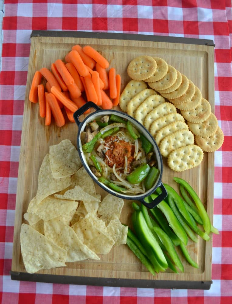 Looking for a filling appetizer or snack? Try this warm Pizza Hummus Dip with crackers, chips, or fresh vegetables.