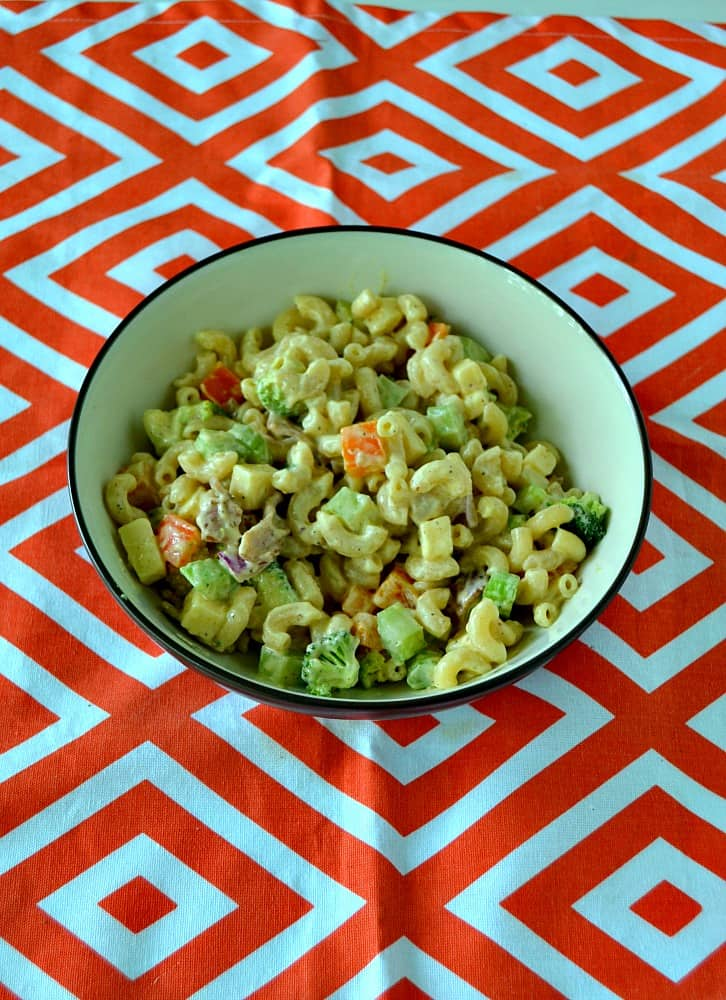 Looking for a great summer salad? Try this awesome Loaded Macaroni Salad with vegetables, cheese, bacon, and more!