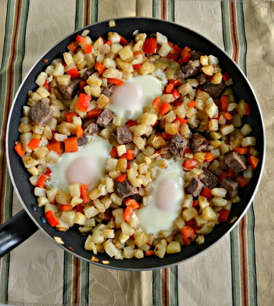 Cooking for a crowd? Make this easy and delicious Steak and Eggs Breakfast Hash!
