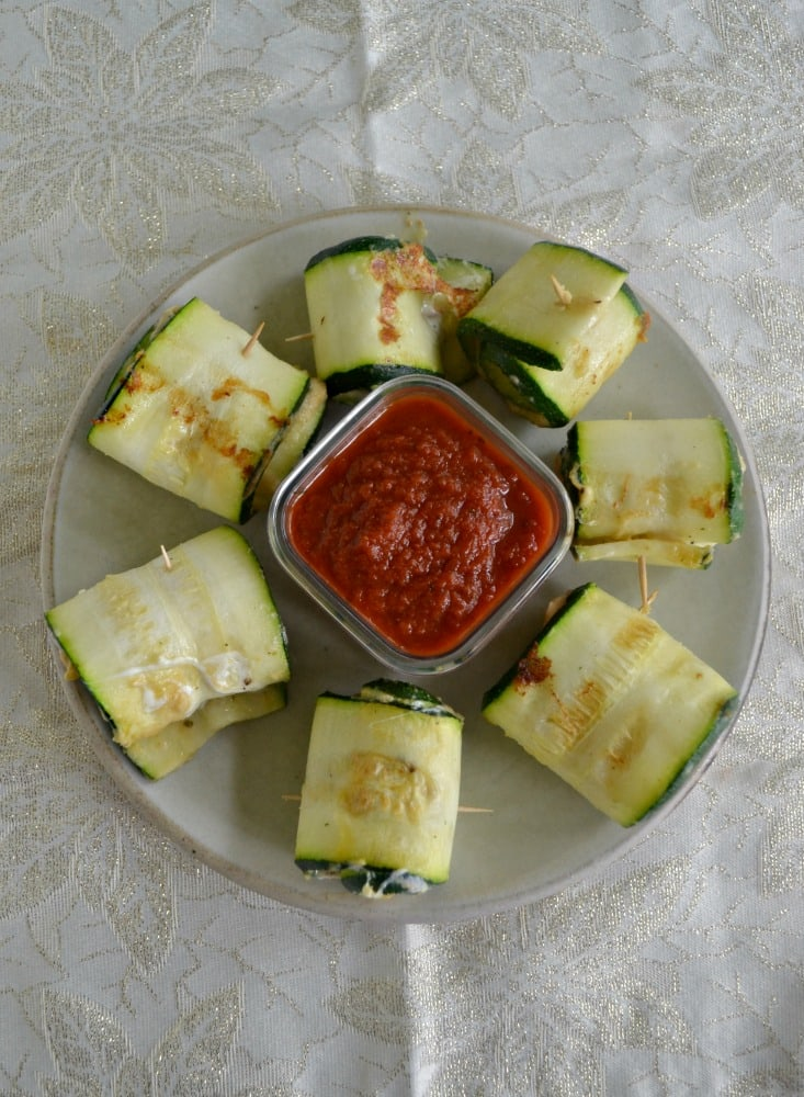 These fresh and delicious Zucchini Roll Ups stuffed with hummus and mozzarella are perfect for a snack or appetizer!