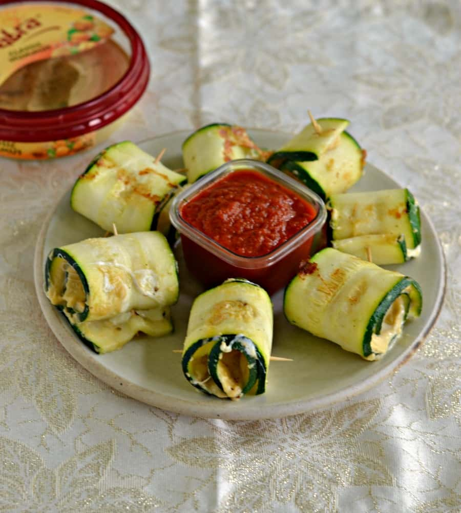 Kids and adults alike will enjoy these tasty Zucchini Roll Ups with Hummus and Mozzarella.