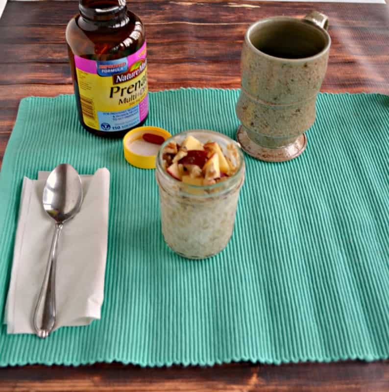 Apple Cinnamon Overnight Oats, a cup of coffe, and Nature Made Prenatal Vitamins is the perfect breakfast to keep mom healthy and happy!