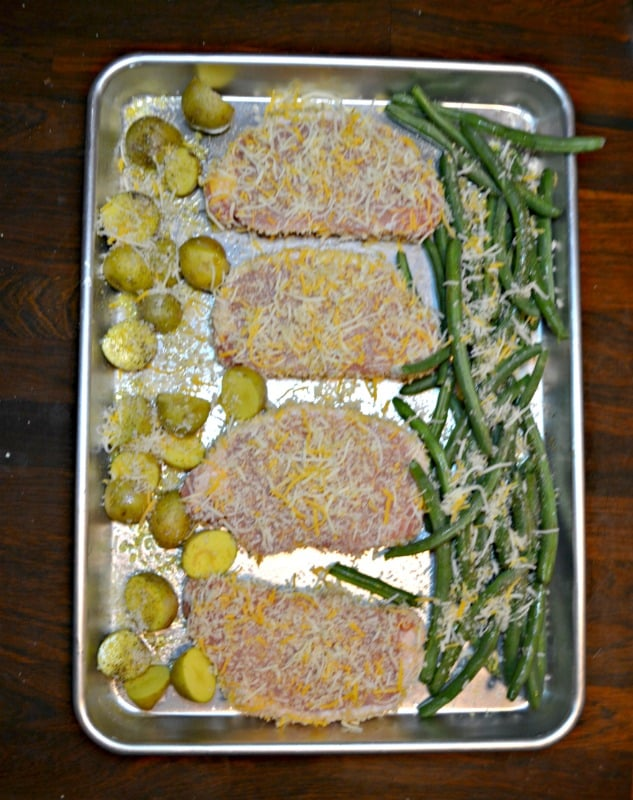 Need a quick dinner? Try these Sheet Pan Parmesan Pork Chops with Potatoes and Green Beans