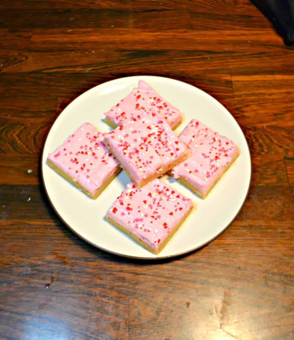 Make these tasty Sugar Cookie Bars and frost them with colored frosting and sprinkles.