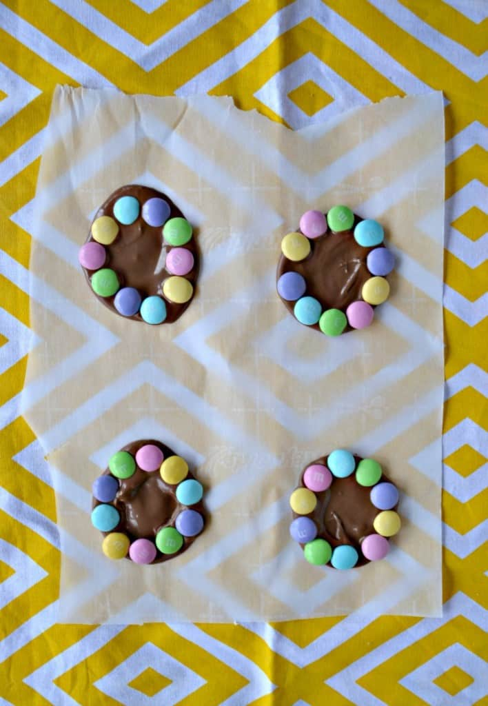 Use melted chocolate and M&M'S® candies to make edible flowers