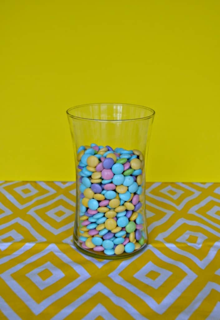 Fill a vase with Pastel M&M'S® candies for an edible centerpiece