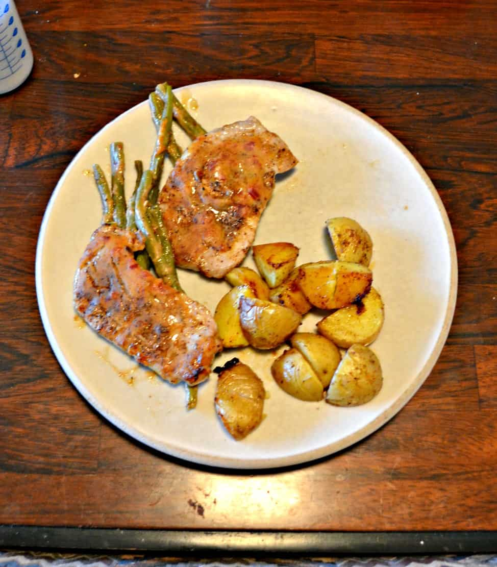 Love this Sheet Pan Chili Dijon Pork Chop meal with Potatoes and Green Beans