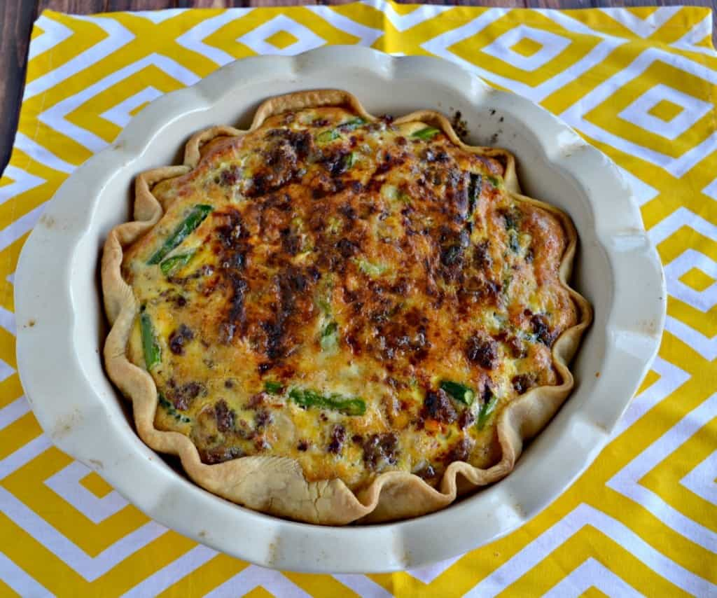 Hosting a brunch? Don't forget the tasty Sausage, Onion, and Asparagus Quiche!