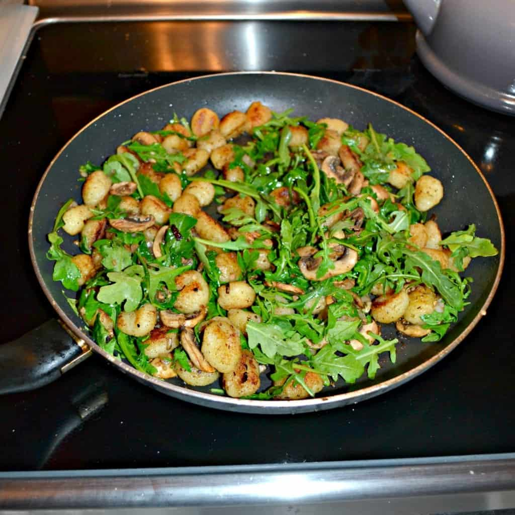 Add some color to your gnocchi with mushrooms and arugula