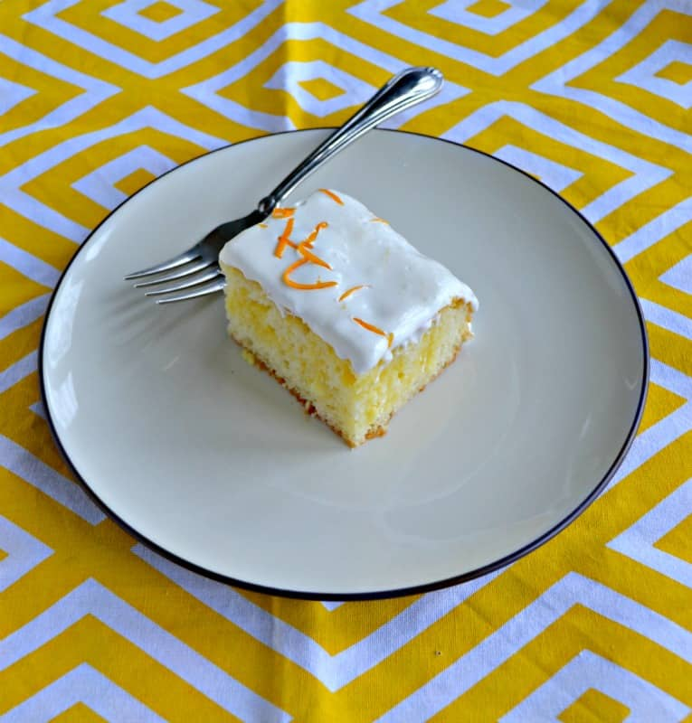 Looking for a stunning summer dessert? Give this easy Lemon Poke Cake a try!