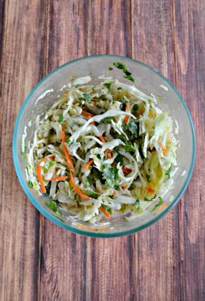 Fresh Cilantro Lime Slaw adds flavor to the Beer Battered Fish Tacos